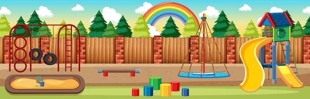 Kinderspeelplaats in het park met regenboog aan de hemel overdag cartoon stijl panorama scène Gratis Vector