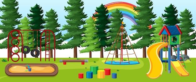 Kinderspeelplaats in het park met regenboog aan de hemel overdag cartoonstijl Gratis Vector