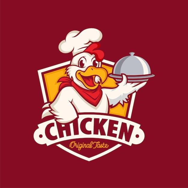 Kip mascotte logo geïsoleerd op donkerrood Premium Vector