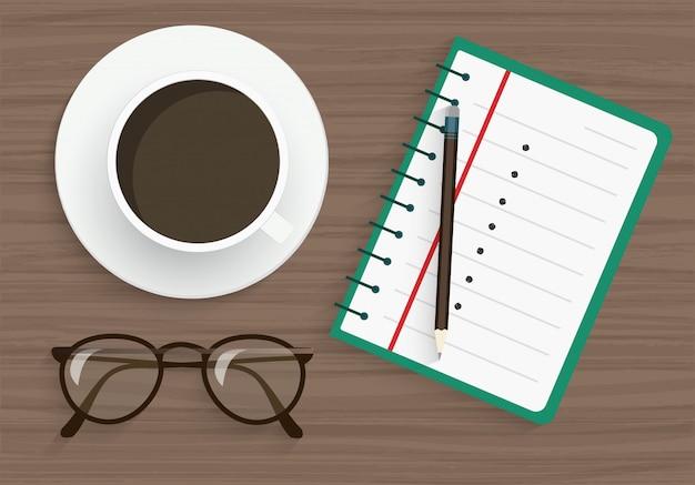 Kladblok, potlood, bril en koffie Premium Vector