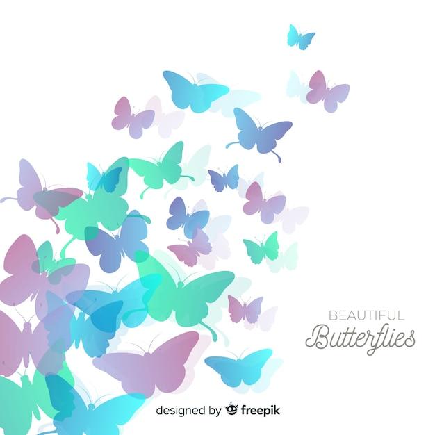 Kleurovergang vlinder zwerm silhouet achtergrond Gratis Vector