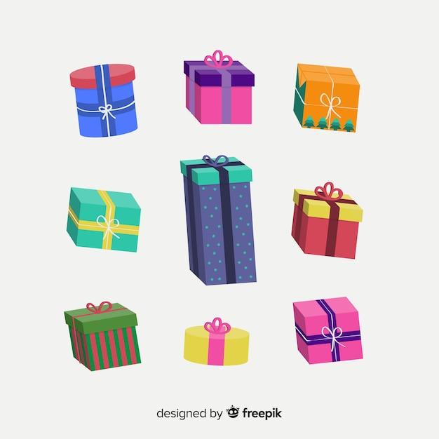 Kleurrijk de giftenpak van kerstmis Gratis Vector