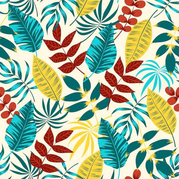 Kleurrijk naadloos patroon met rode en blauwe bladeren en planten Premium Vector