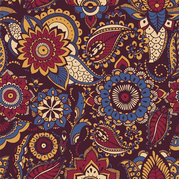 Kleurrijk perzisch paisley naadloos patroon met butamotief en oosterse bloemenmehndi-elementen op donkere achtergrond Premium Vector
