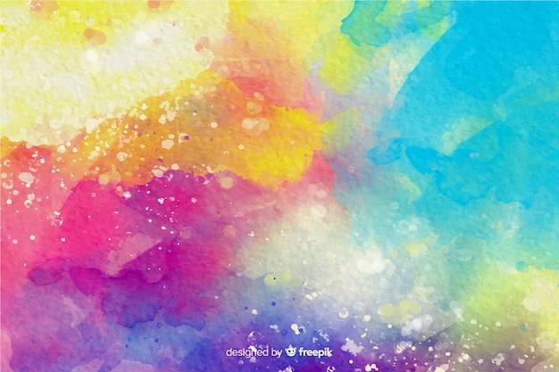 Kleurrijke aquarel effect achtergrond Gratis Vector