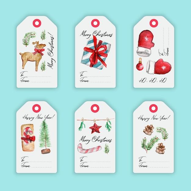 Kleurrijke aquarel merry christmas-etiketten met kerstmiselementen en hand getrokken brieven. Premium Vector
