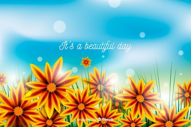 Kleurrijke bloemenachtergrond met inspirerend citaat Gratis Vector