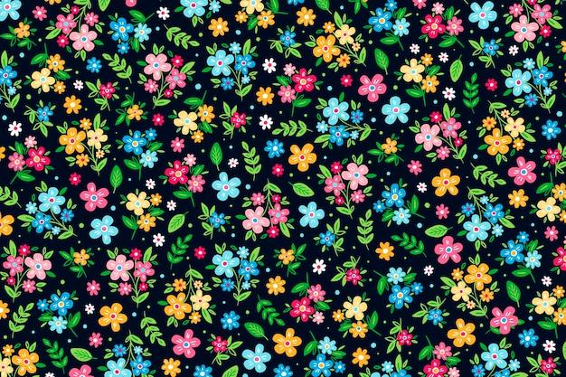 Kleurrijke ditsy bloemenprintachtergrond Gratis Vector