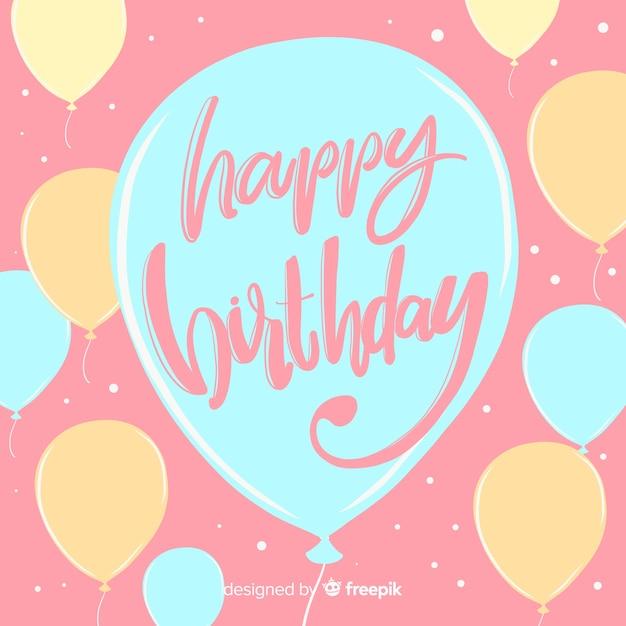Kleurrijke gelukkige verjaardag belettering achtergrond Gratis Vector