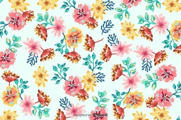Kleurrijke geschilderde bloemen decoratieve achtergrond Gratis Vector