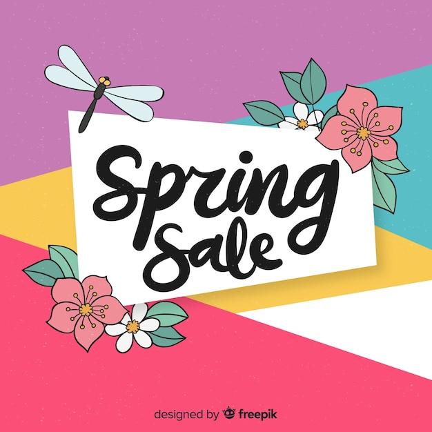 Kleurrijke lente verkoop achtergrond Gratis Vector