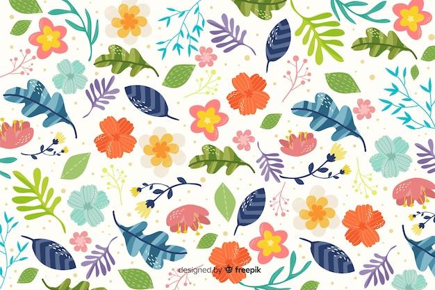 Kleurrijke vlakke bloemen decoratieve achtergrond Gratis Vector