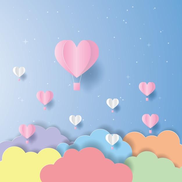 Kleurrijke wolk met roze en witte hart hete luchtballon in papier knippen Premium Vector