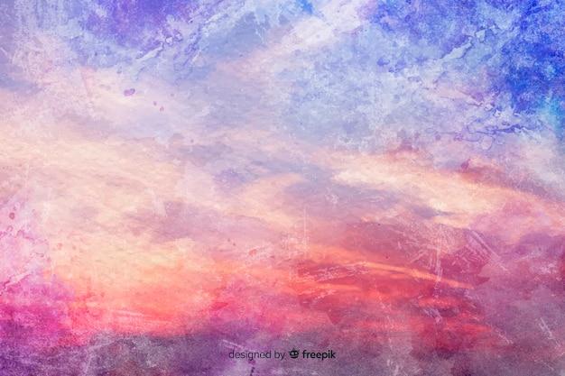 Kleurrijke wolken op waterverfachtergrond Gratis Vector