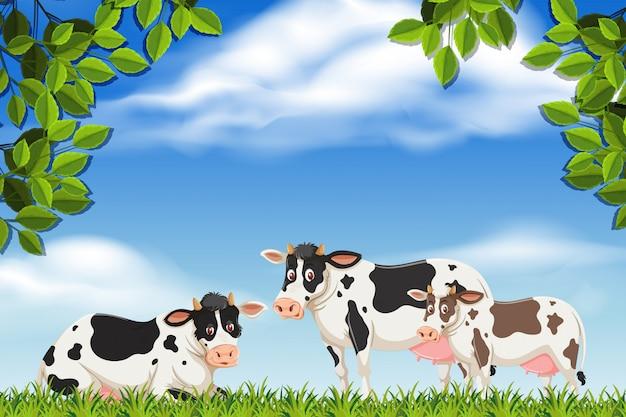 Koeien in natuurscène Premium Vector