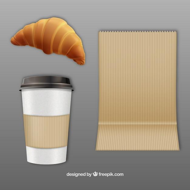 Koffie en een croissant om mee te nemen Gratis Vector