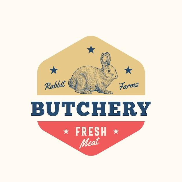 Konijnenboerderijen vers vlees abstract teken, symbool of logo sjabloon. hand getrokken konijn sillhouette met retro typografie. vintage embleem. Premium Vector