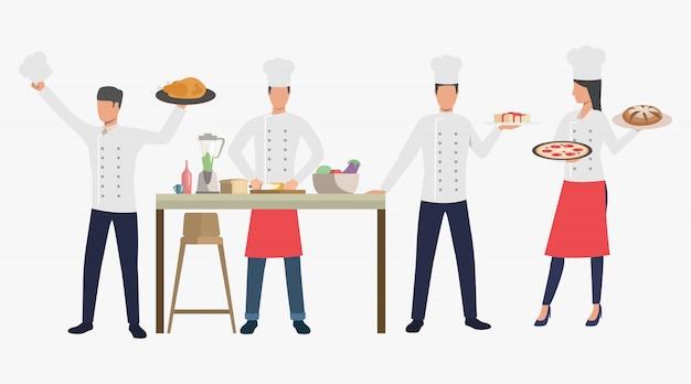 Kookt met gerechten in de keuken van het restaurant Gratis Vector