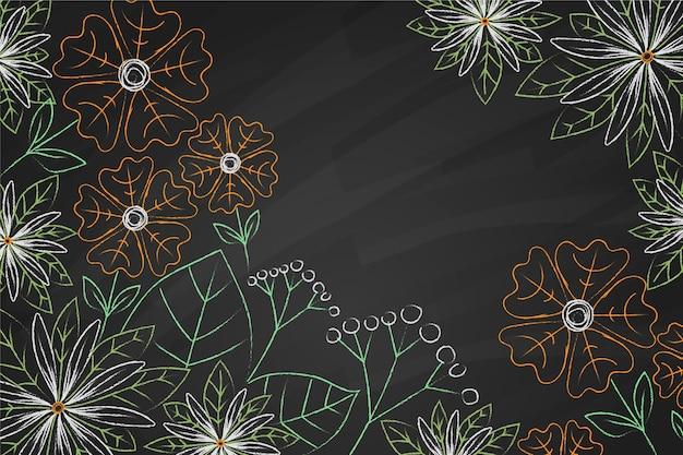 Kopieer ruimte bloemen op blackboard achtergrond Gratis Vector