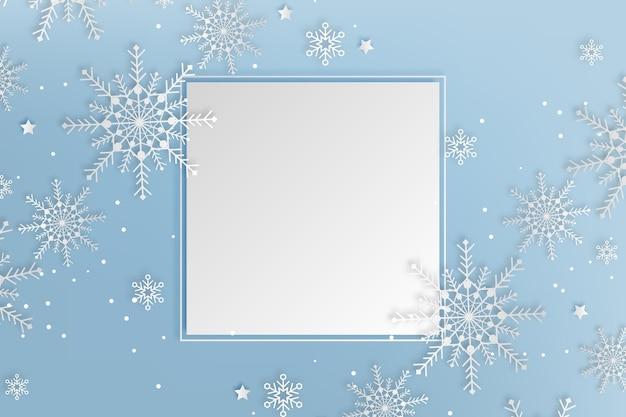 Kopieer ruimte winter achtergrond in papierstijl en sneeuwvlokken Gratis Vector