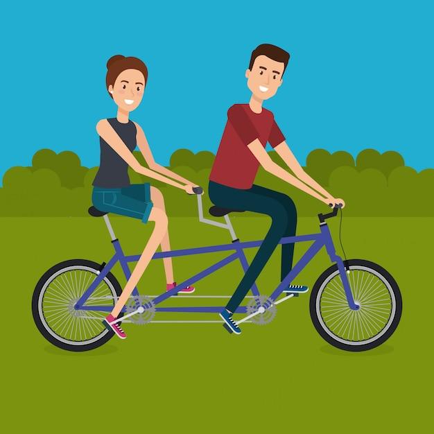 Koppel met fiets in het landschap Gratis Vector