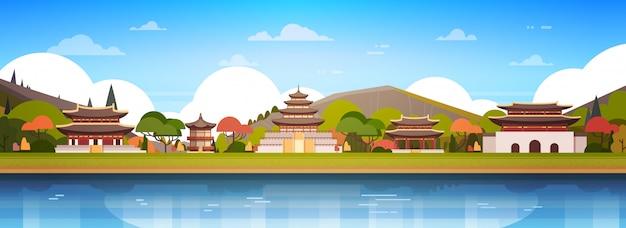 Korea paleizen op rivierlandschap zuid-koreaanse tempel over bergen beroemde aziatische bezienswaardigheid horizontaal bekijken Premium Vector