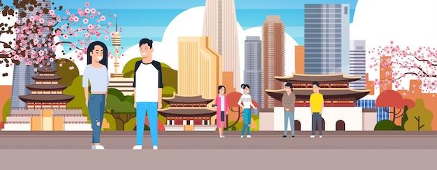 Koreaans paar over de stad van seoel Premium Vector