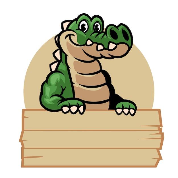 Krokodil cartoon mascotte houdt het lege houten bord Premium Vector