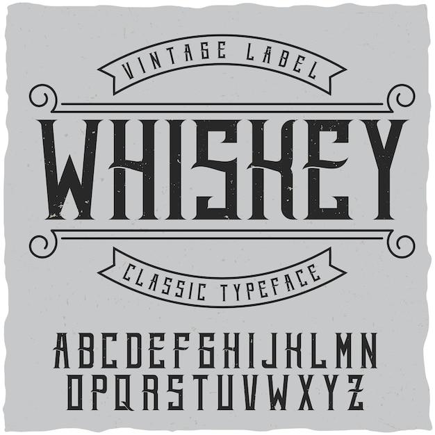 Label lettertype en voorbeeld labelontwerp met decoratie. vintage lettertype, goed te gebruiken in labels in vintage stijl van alcoholische dranken - absint, whisky, gin, rum, whisky, bourbon enz. Gratis Vector