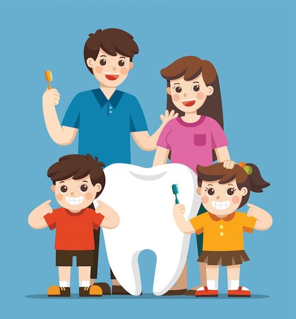 Lachende kinderen met ouders staan naast grote witte tand. ze houden een tandenborstel met een gezonde, schone tand. hygiëne en verzorging. Premium Vector