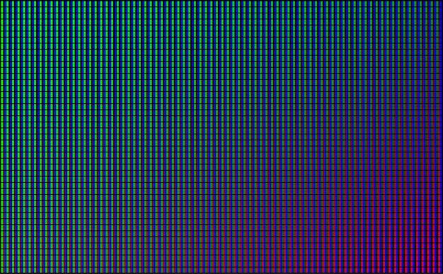 Led muur videoscherm met groene, blauwe en rode stip lichten op zwarte achtergrond. Gratis Vector