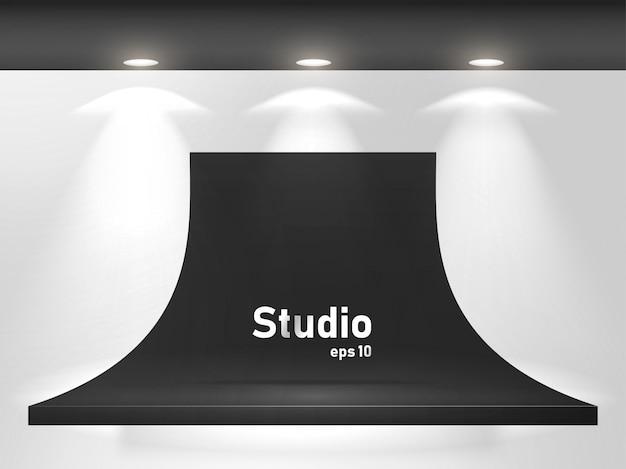 Lege heldere zwarte tafel in de studio ruimte voor het weergeven van inhoud ontwerp. Premium Vector