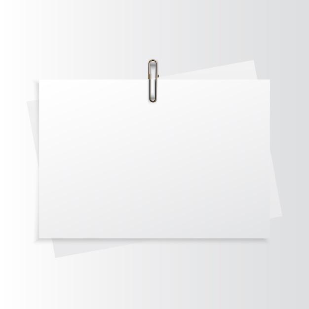 Lege horizontale papier realistische mock-up met gouden paperclip Premium Vector