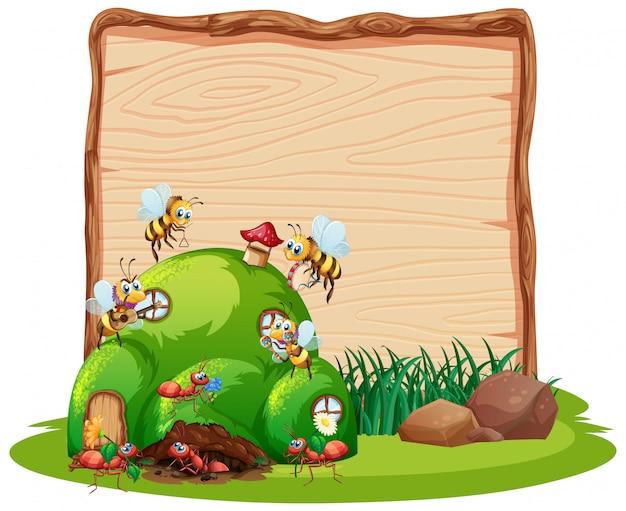 Lege houten raad in aard met dierlijke geïsoleerde tuin Gratis Vector