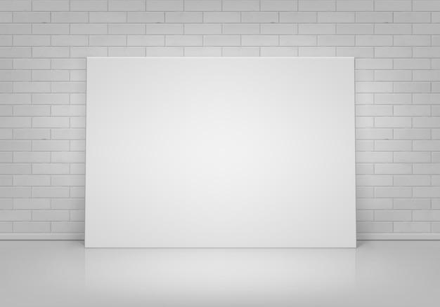 Lege lege witte mock up poster fotolijst staande op de vloer met bakstenen muur vooraanzicht Premium Vector