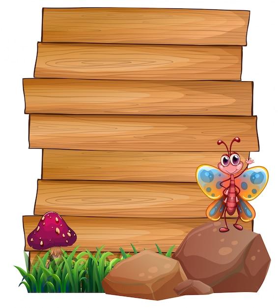 Lege uithangborden met een vlinder boven een rots Gratis Vector