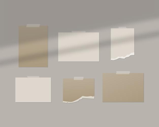 Lege vellen wit papier op de muur met schaduw overlay. Premium Vector