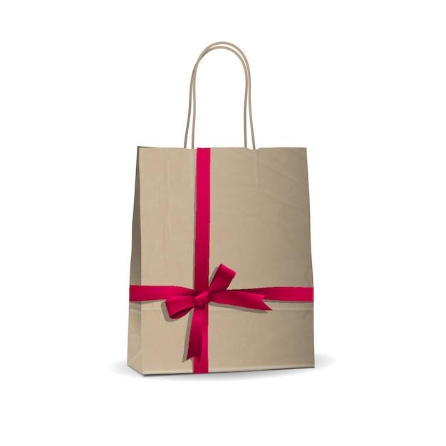Lege winkelen bruine tas met gebonden roze lint Premium Vector
