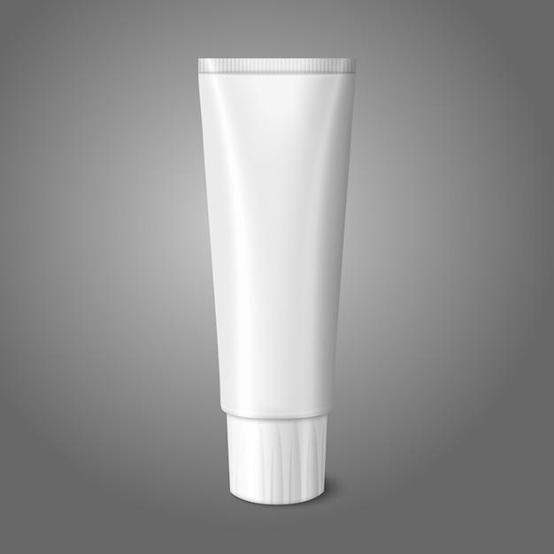 Lege witte realistische buis voor tandpasta, lotion, cosmetica, medicijncrème enz. op grijze achtergrond met plaats voor uw en branding. Premium Vector