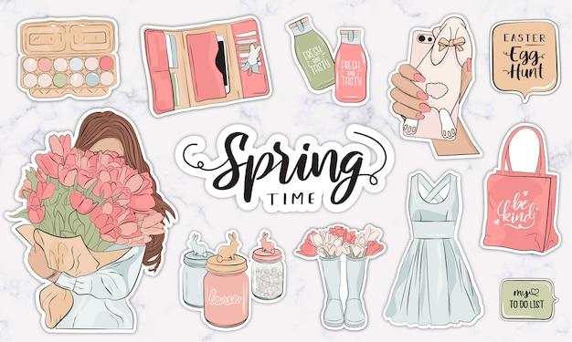 Lente stickers collectie met moderne vrouwelijke mode-objecten en accessoires Premium Vector