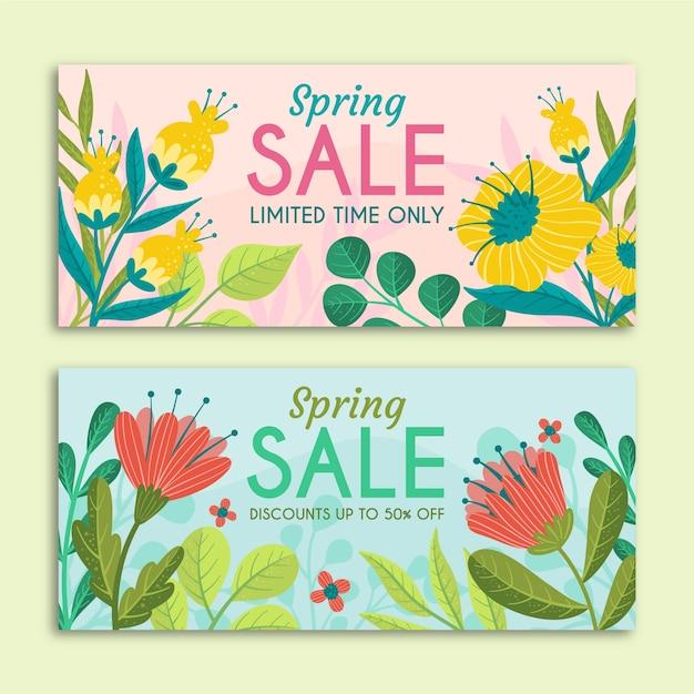 Lente verkoop banners met hand getrokken bloemen Gratis Vector