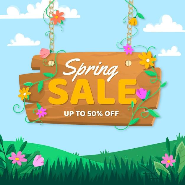 Lente verkoop met gras en bloemen Gratis Vector