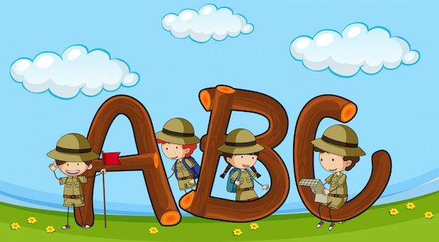 Lettertype abc met kinderen in uniform voor jongens Gratis Vector