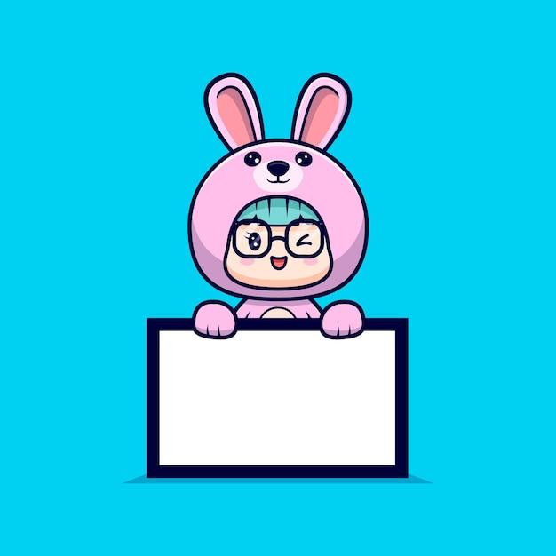 Leuk meisje dat konijntjeskostuum draagt dat witte lege tekstraad houdt Premium Vector