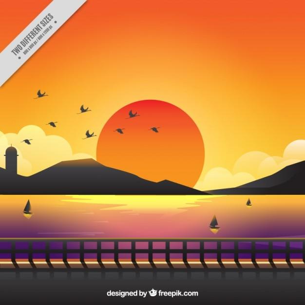 Leuke achtergrond van een zonsondergang met warme kleuren Gratis Vector