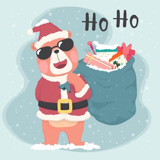 Leuke bruine beer santa draagt een zonnebril en houdt zak met geschenken, vrolijke kerstkaart Premium Vector