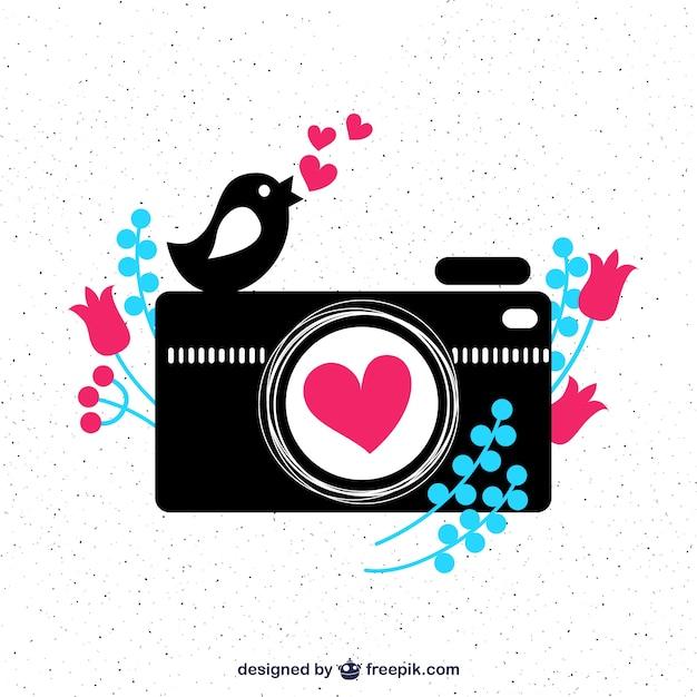 Leuke camera en een vogel Gratis Vector