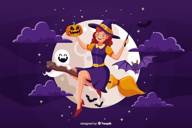 Leuke halloween-heks met bezem Gratis Vector