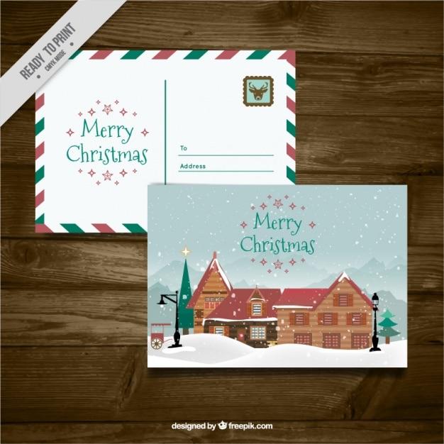 Leuke kerst ansichtkaarten met een cabine Gratis Vector
