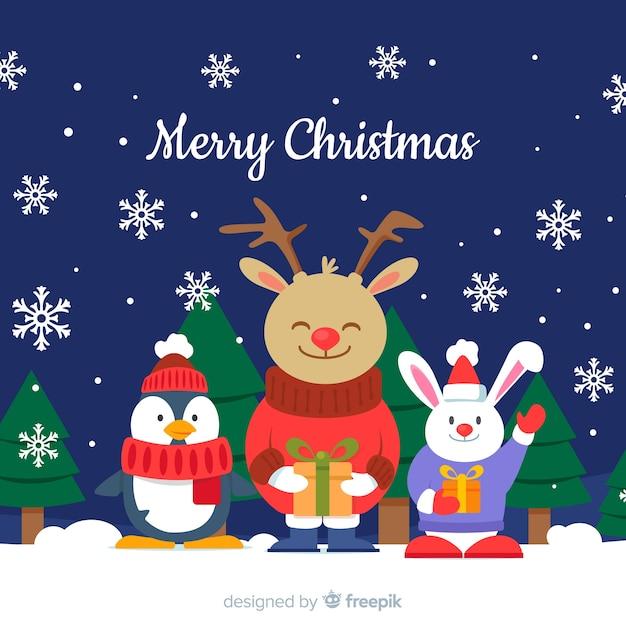 Leuke kerst dieren achtergrond Gratis Vector